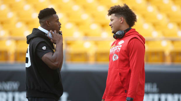 Aug 17, 2019; Pittsburgh, PA, USA; Pittsburgh Steelers wide receiver JuJu Smith-Schuster (left) and Kansas City Chiefs quarterback Patrick Mahomes (right) talk on the field before playing at Heinz Field. Mandatory Credit: Charles LeClaire-USA TODAY Sports