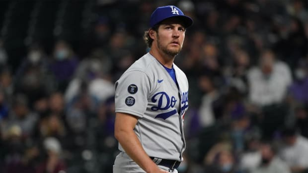 Apr 2, 2021; Denver, Colorado, USA; Los Angeles Dodgers starting pitcher Trevor Bauer (27) leaves the mound in fifth inning against the Colorado Rockies at Coors Field.