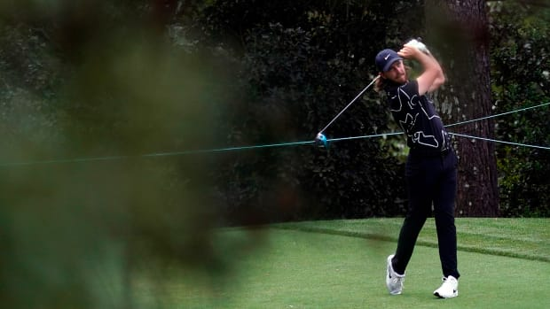 Apr 8, 2021; Augusta, Georgia, USA; Tommy Fleetwood hits his tee shot on the 15th hole during the first round of The Masters golf tournament.