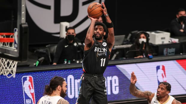 Nets point guard Kyrie Irving making a jump shot