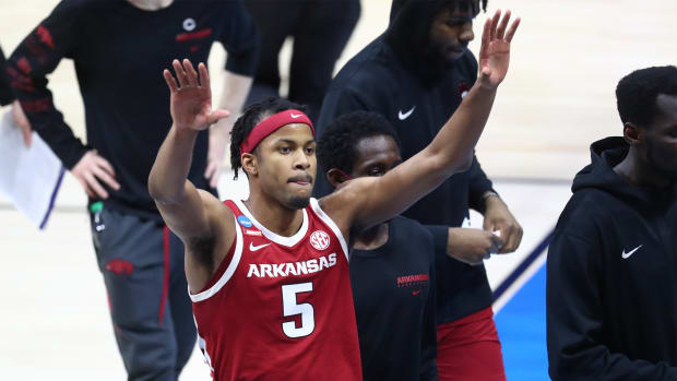 Mar 29, 2021; Indianapolis, Indiana, USA; Arkansas Razorbacks guard Moses Moody (5) waves to the stands while leaving the court after the game in the Elite Eight of the 2021 NCAA Tournament against the Baylor Bears at Lucas Oil Stadium.