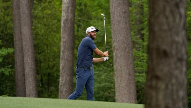 Apr 9, 2021; Augusta, Georgia, USA; Dustin Johnson hits his second shot on the 11th hole during the second round of The Masters golf tournament.