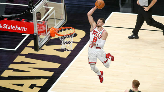 Apr 9, 2021; Atlanta, Georgia, USA; Chicago Bulls guard Zach LaVine (8) shoots against the Atlanta Hawks in the first quarter at State Farm Arena.