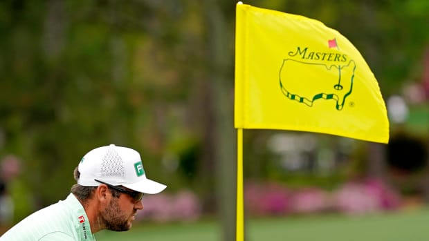 Apr 10, 2021; Augusta, Georgia, USA; Corey Conners lines up his putt on the second green during the third round of The Masters golf tournament.