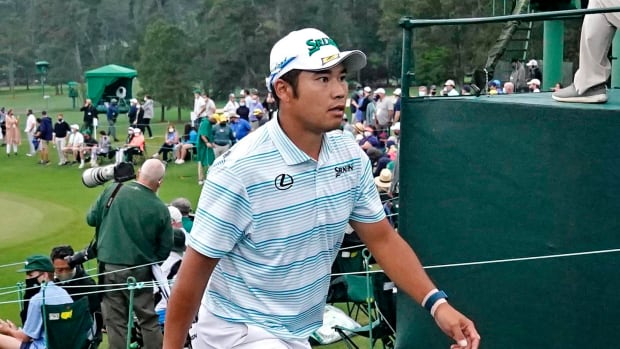 Hideki Matsuyama walks off after the third round of the Masters.