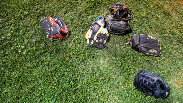 Baseball gloves on a field.