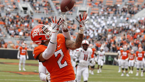 Oklahoma State Cowboys wide receiver Tylan Wallace (2) catches a touchdown pass during a football game against Texas Tech at Boone Pickens Stadium.