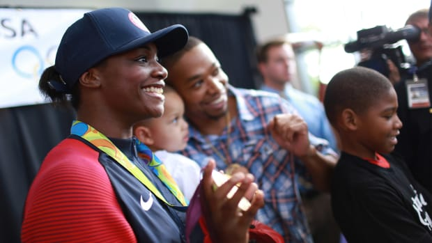 Olympic gold medalist Claressa Shields takes photos with fans on Tuesday, Aug. 23, 2016 at Bishop International Airport in Flint, Mich. Shields returned home from winning her second gold medal in women's boxing during the 2016 Olmpics in Rio de Janeiro, Brazil.