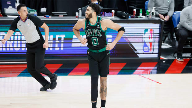 Apr 13, 2021; Portland, Oregon, USA; Boston Celtics small forward Jayson Tatum (0) reacts after a shot during the second half against the Portland Trail Blazers at Moda Center.