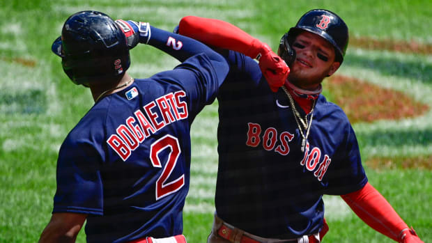 Boston Red Sox center fielder Alex Verdugo (99) celebrates with shortstop Xander Bogaerts (2) after hitting a three-run home run against the Baltimore Orioles at Oriole Park at Camden Yards.