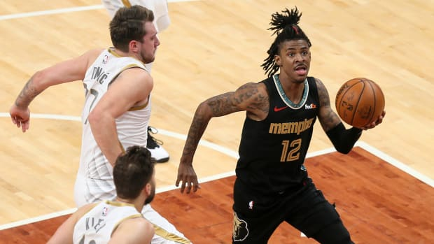 Grizzlies point guard Ja Morant holding a basketball