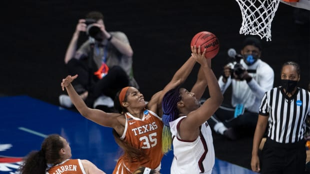 Mar 30, 2021; San Antonio, TX, USA; Texas Longhorns forward Charli Collier (35) blocks a shot by South Carolina Gamecocks forward Aliyah Boston (right) during the first half in the Elite Eight round of the Women's NCAA tournament at the Alamodome.