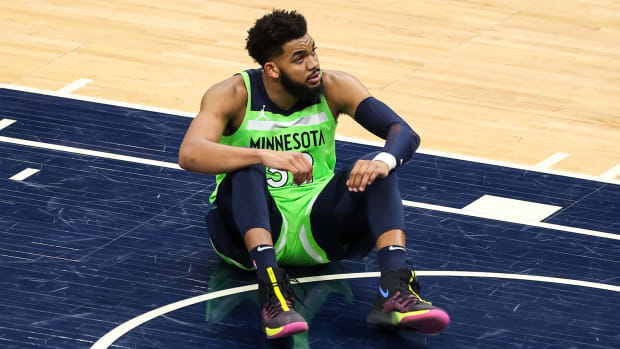 Timberwolves center Karl-Anthony Towns sitting on the court