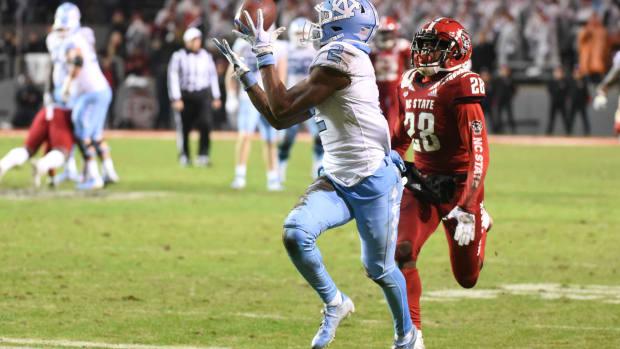 Nov 30, 2019; Raleigh, NC, USA; North Carolina Tar Heels receiver Dyami Brown (2) catches a touchdown pass against North Carolina State Wolfpack defensive back Kishawn Miller (28) during the second half at Carter-Finley Stadium. The Tar Heels won 41-10. Mandatory Credit: Rob Kinnan-USA TODAY Sports