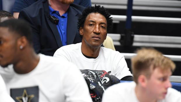 Scottie Pippen watching a basketball game