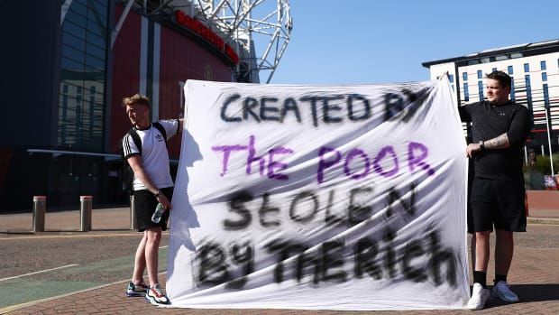 Fans protest the Super League outside of Old Trafford