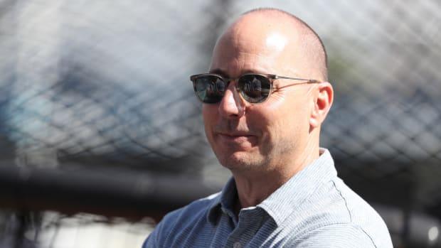 Yankees GM Brian Cashman smiling