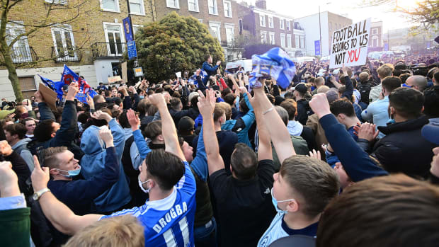 Chelsea fans celebrate the club's Super League withdrawal