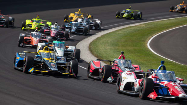 Cars bunch up after a restart in turn one during the 104th Indianapolis 500 at Indianapolis Motor Speedway on Sunday, Aug. 23, 2020. Indy 500 2020