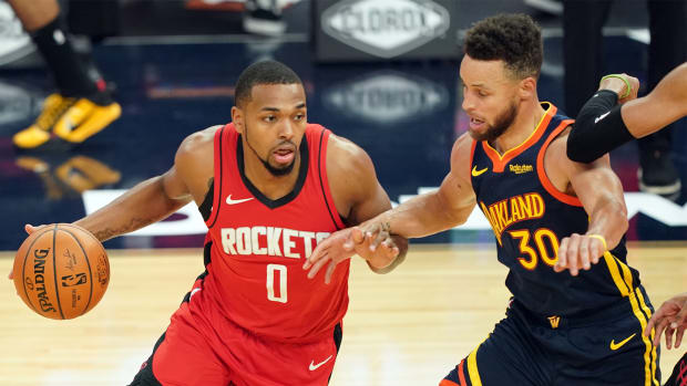 Apr 10, 2021; San Francisco, California, USA; Houston Rockets forward Sterling Brown (0) dribbles while being defended by Golden State Warriors guard Stephen Curry (30) during the first quarter at Chase Center.
