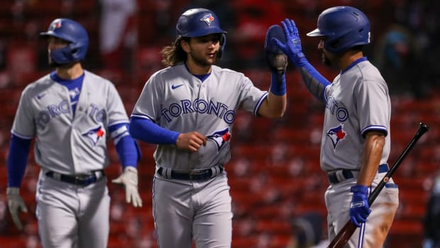 Blue Jays' Bo Bichette celebrates after crossing home plate