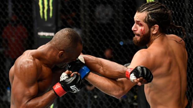 Kamaru Usman and Jorge Masvidal trade blows in the UFC Octagon