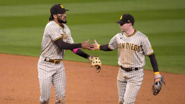 Padres' Fernando Tatis Jr. and Jake Cronenworth celebrate on the field