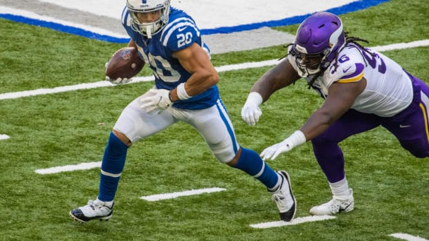 Sep 20, 2020; Indianapolis, Indiana, USA; Indianapolis Colts running back Jordan Wilkins (20) runs the ball while Minnesota Vikings defensive tackle Armon Watts (96) in the game at Lucas Oil Stadium. Mandatory Credit: Trevor Ruszkowski-USA TODAY Sports