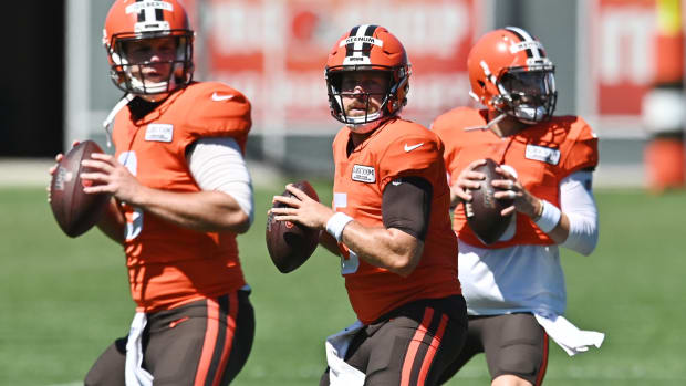 Aug 19, 2020; Berea, Ohio, USA; Cleveland Browns quarterback Case Keenum (center) works on a drill wit quarterback Garrett Gilbert (left) and quarterback Baker Mayfield (right) during training camp at the Cleveland Browns training facility. Mandatory Credit: Ken Blaze-USA TODAY Sports