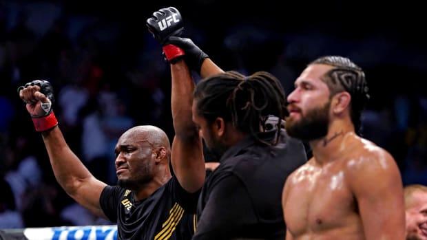 Kamaru Usman (Red Gloves) reacts after defeating Jorge Masvidal (Blue Gloves) during UFC 261 at VyStar Veterans Memorial Arena.
