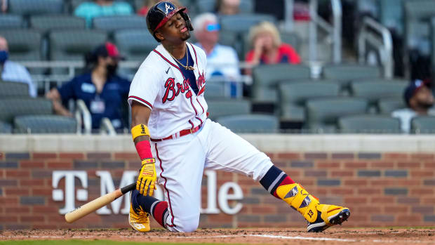 Apr 25, 2021; Cumberland, Georgia, USA; Atlanta Braves right fielder Ronald Acuna Jr. (13) reacts after hitting a fly ball for an out against the Arizona Diamondbacks during the fourth inning at Truist Park.