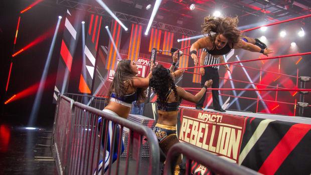 """Impact Wrestling's Jordynne Grace dives outside the ring at the """"Rebellion"""" PPV"""