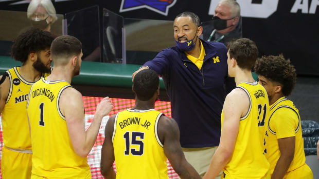 Michigan coach Juwan Howard instructs his team