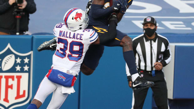 Chargers receiver Mike Williams makes this catch against Bills' Levi Wallace but can't stay inbounds on the play.