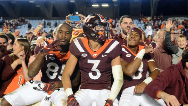 Oct 13, 2018; Chapel Hill, NC, USA; Virginia Tech Hokies defensive back Caleb Farley (3) tight end Chris Cunningham (85) and wide receiver Phil Patterson (8) celebrate with fans after a win against the North Carolina Tar Heels at Kenan Memorial Stadium. The Hokies won 22-19. Mandatory Credit: Rob Kinnan-USA TODAY Sports