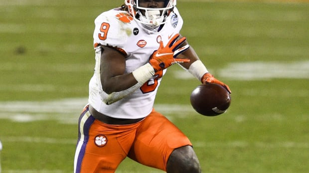 Clemson Tigers running back Travis Etienne (9) with the ball in the third quarter at Bank of America Stadium.