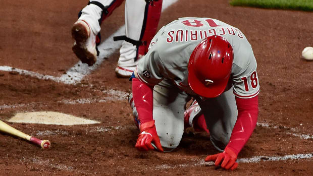 Philadelphia Phillies shortstop Didi Gregorius (18) falls to the ground after he was hit by a pitch from St. Louis Cardinals relief pitcher Genesis Cabrera.