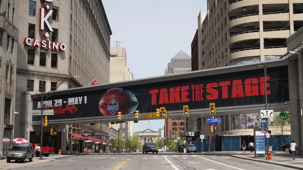 """Apr 28, 2021; Cleveland, Ohio, United States; A pedestrian bridge with the words \""""Take the Stage\"""" prior to the 2021 NFL Draft at the intersection of Prospect Ave and Ontario St. in downtown. Mandatory Credit: Kirby Lee-USA TODAY Sports"""
