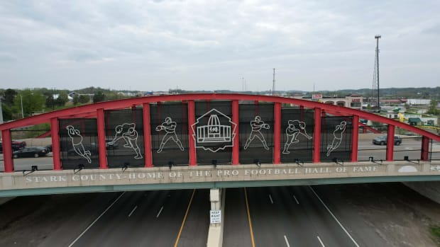"""Apr 28, 2021; Cleveland, Ohio, United States; A pedestrian bridge with the words \""""Take the Stage\"""" prior to the 2021 NFL Draft at the intersection of Prospect Ave and Ontario St. in downtown."""