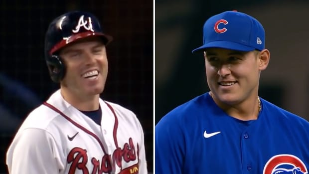 Anthony Rizzo and Freddie Freeman smile during their matchup