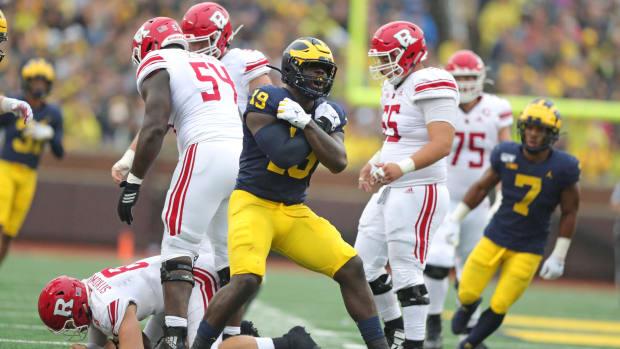 Michigan defensive lineman Kwity Paye sacks Rutgers quarterback Artur Sitkowski during the first half on Saturday, Sept. 28, 2019, at Michigan Stadium. Michigan Football