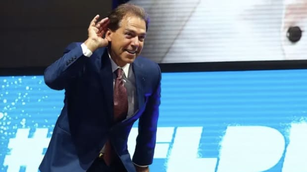 Nick Saban hears it from the crowd at the NFL draft
