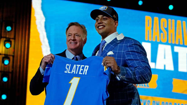 Apr 29, 2021; Cleveland, Ohio, USA; Rashawn Slater (Northwestern) with NFL commissioner Roger Goodell after being selected by the Los Angeles Chargers as the number 13 overall pick in the first round of the 2021 NFL Draft at First Energy Stadium. Mandatory Credit: Kirby Lee-USA TODAY Sports