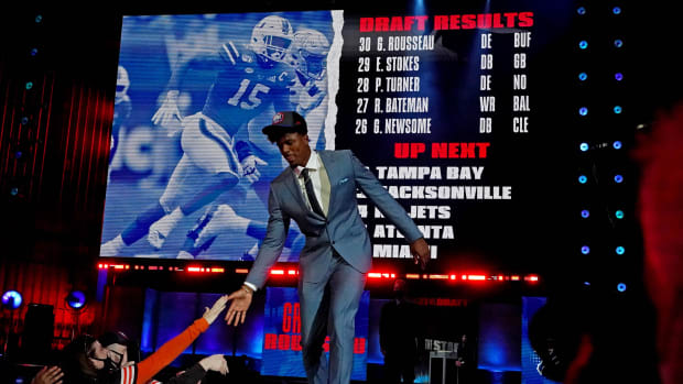 Gregory Rousseau (Miami) walks on stage after being selected by the Buffalo Bills as the number 30 overall pick in the first round of the 2021 NFL Draft at First Energy Stadium.