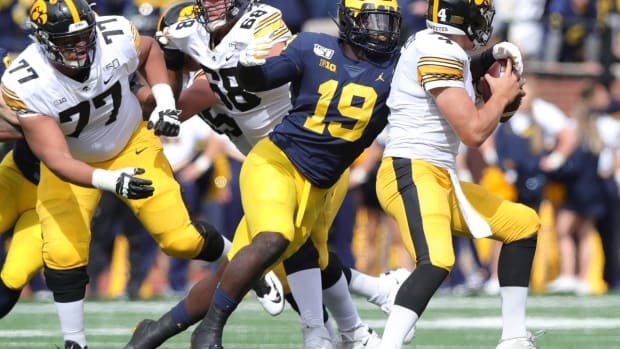 Michigan defensive lineman Kwity Paye sacks the Iowa quarterback Nate Stanley during the first half on Saturday, Oct. 5, 2019, at Michigan Stadium. Michigan Football