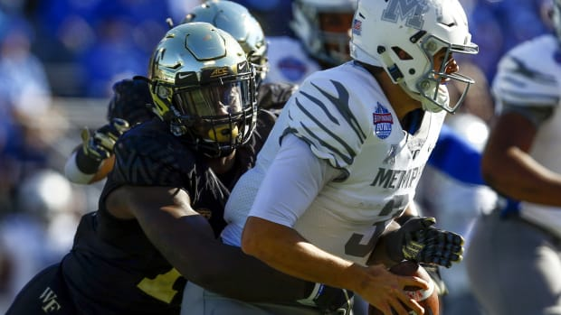 Memphis Tigers quarterback Brady White (3) is sacked by Wake Forest Demon Deacons defensive lineman Carlos Basham Jr. (18) during the first half of the Birmingham Bowl at Legion Field.