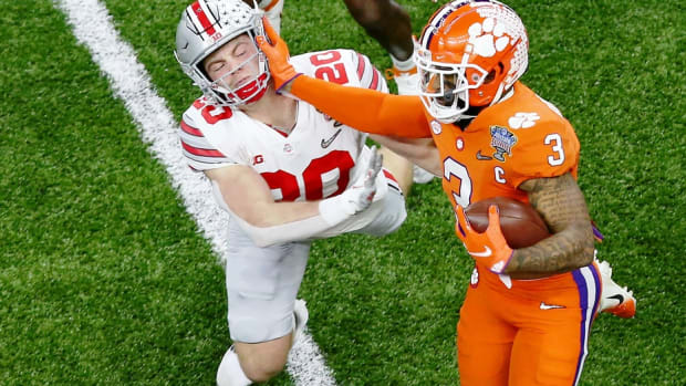 Clemson Tigers wide receiver Amari Rodgers (3) stiff arms Ohio State Buckeyes linebacker Pete Werner (20) during the first quarter at Mercedes-Benz Superdome.