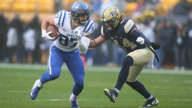 Oct 27, 2018; Pittsburgh, PA, USA; Duke Blue Devils tight end Noah Gray (87) runs after a catch against Pittsburgh Panthers linebacker Elias Reynolds (44) during the first quarter at Heinz Field. Mandatory Credit: Charles LeClaire-USA TODAY Sports