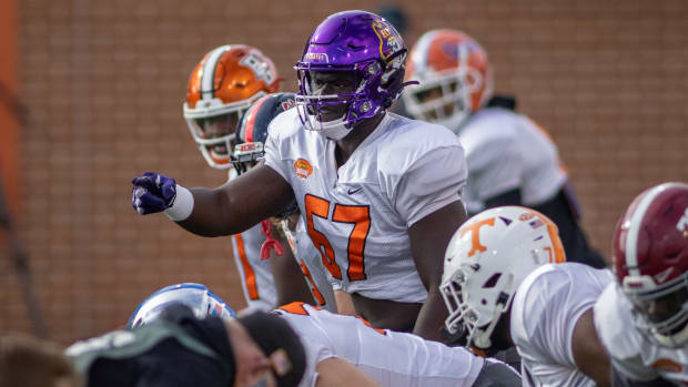 Jan 27, 2021; American offensive lineman D'Ante Smith of East Carolina (67) gestures in drills during American practice at Hancock Whitney Stadium in Mobile, Alabama, USA; Mandatory Credit: Vasha Hunt-USA TODAY Sports