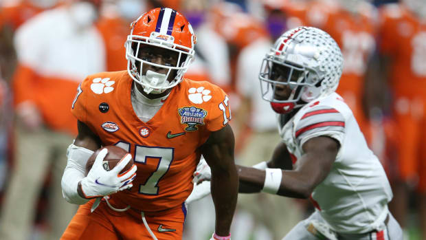 Jan 1, 2021; New Orleans, LA, USA; Clemson Tigers wide receiver Cornell Powell (17) runs the ball past Ohio State Buckeyes cornerback Sevyn Banks (7) during the second half at Mercedes-Benz Superdome. Mandatory Credit: Chuck Cook-USA TODAY Sports